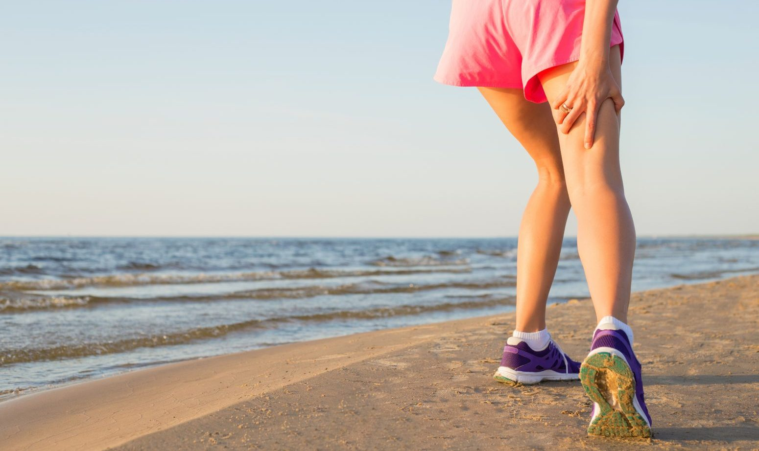Female runner with pulled hamstring