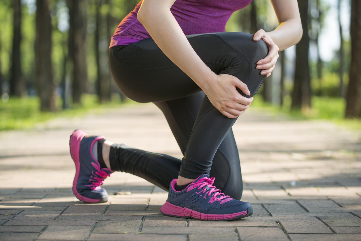 Asian woman runner hold Knee Pain ,Human Leg, jogging